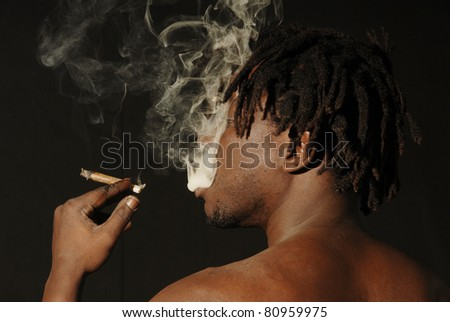 African marijuana smoker - stock photo