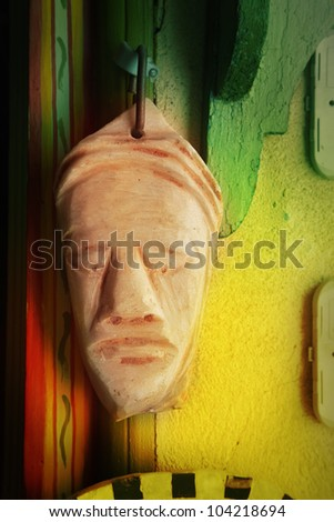 African mask on wall