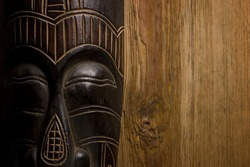 African mask over wooden background with copy space