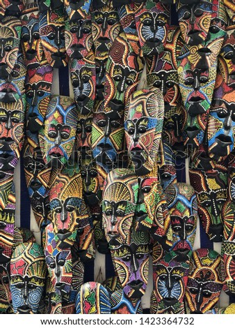 African masks displayed at the market of marrakech morocco. Old medina shop. Art display handmade objects. Culture objects africa.