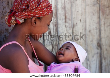 African mother with baby girl, location Mmankgodi village , Botswana