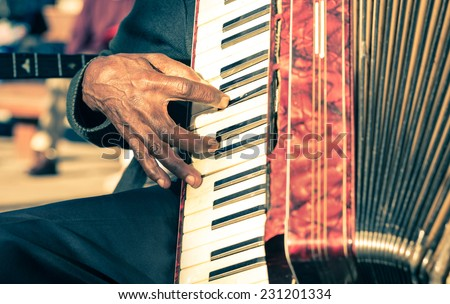 African musician hand playing fisarmonica - Street artist performing traditional songs with accordion
