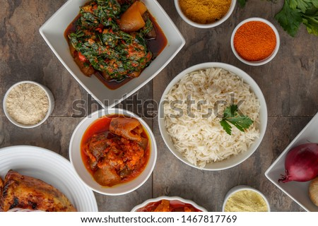 African National Food Dish. Grilled Meat and Chicken Dish. Wings Homemade with Plantain with Jollof Rice. Nigerian Jollofrice. Grilled African Fish Dish & Meal Jelly Food. Banana Meal