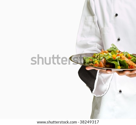 African or American chef presenting healthy food chicken salad