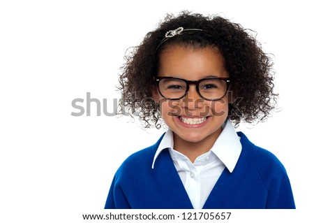 African origin bespectacled primary girl on a white background.