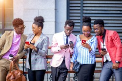 african people is talking by skype with foreign students. addiction of phones. communication concept