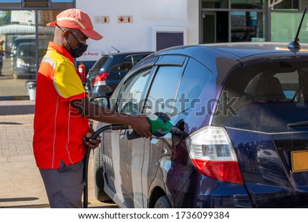 African petrol attendant at a gas station in Botswana Photo stock ©