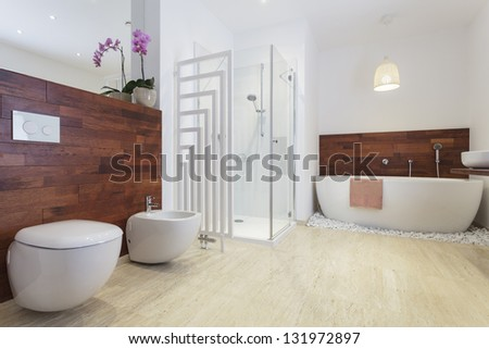 African style bathroom with exotic wood and free standing bath. #131972897