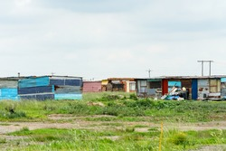 African tin shacks in a poor rural community in South Africa showing poverty and hardship in daily life and living conditions