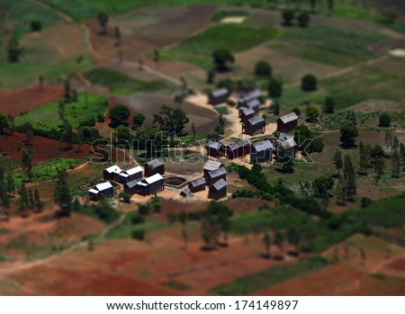 African village with buildings and cultivated areas. Madagascar - stock photo