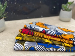 African wax print of different shades and pattern in a grey setting