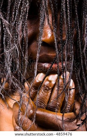 African witch, dramatization, focus on the hair - stock photo