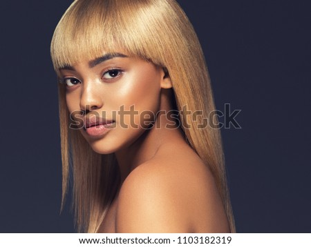 African woman beauty skin care iover gray background portrait
