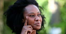 African woman having a breakthough idea, person eureka moment
