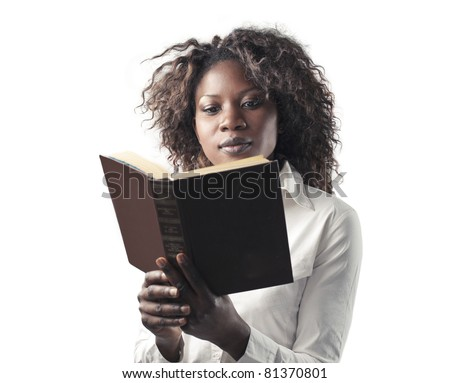 African woman reading a book