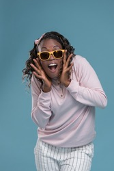 African woman wearing sunglasses and expressing positivity