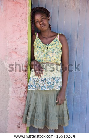 African woman with braids dressed in colorful clothes