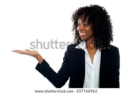 African woman with open palm. Copy space business concept