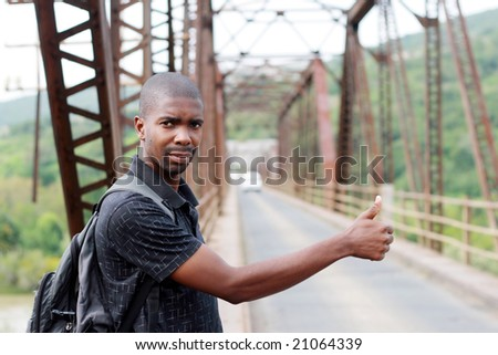 african young man hitchhiking