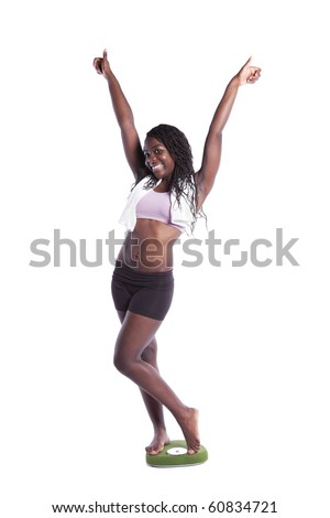 african young woman happy with her diet results (isolated on white)