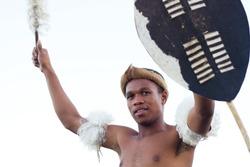 african zulu man holding traditional shield