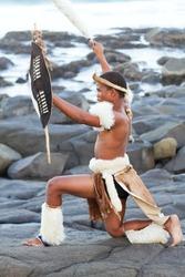 african zulu man on beach