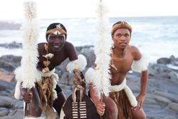 african zulu man posing on beach