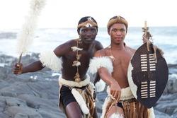 african zulu men on beach