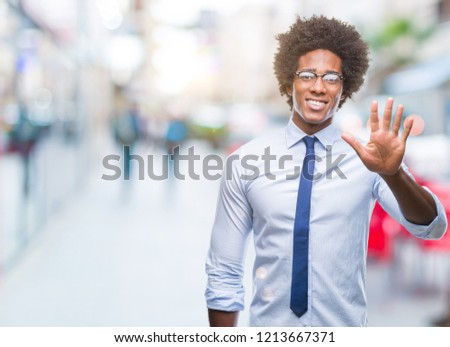 Afro american business man wearing glasses over isolated background showing and pointing up with fingers number five while smiling confident and happy. #1213667371