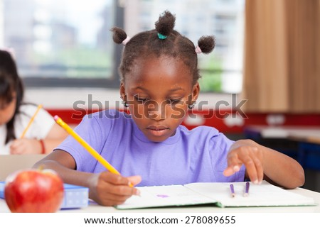 Afro american girl in elementary school.