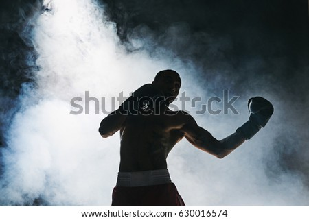 Photo of  Afro american male boxer.