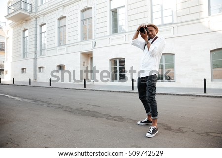 Afro american photographer on the street. photographed