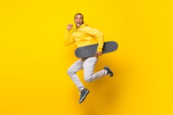 Afro American skater man over isolated white background