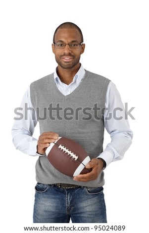 Afro-American smart young man with American football smiling at camera.?