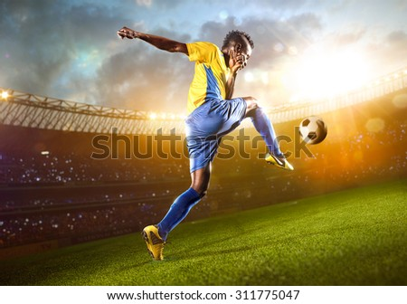 Afro-American soccer player in action. Stadium field
