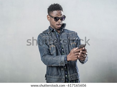 Afro american young man talking on the phone