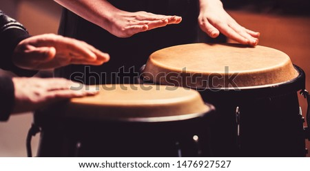 Afro Cuba, rum, drummer, fingers, hand, hit. Drum. Hands of a musician playing on bongs. The musician plays the bongo. Close up of musician hand playing bongos drums.
