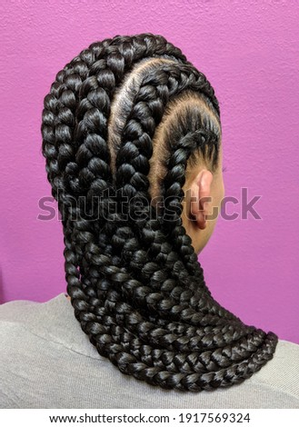 Afro Hair Braided In A Cornrow Hairstyle Using Synthetic Hair Extensions Stock photo ©