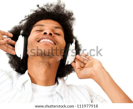 Afro man enjoying listening to music  - isolated over a white background