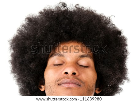 Afro man with eyes closed - isolated over a white background #111639980