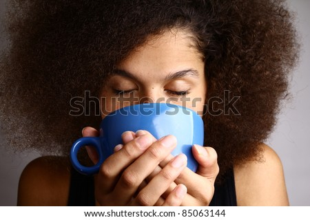 afro woman drinking