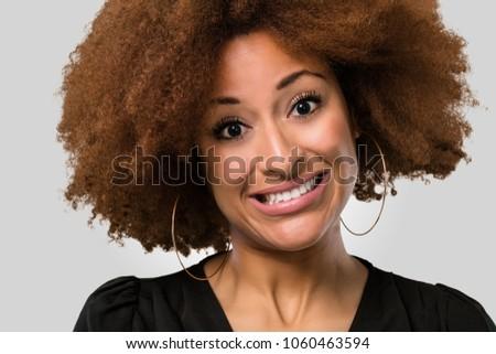 afro woman face closeup fake smiling