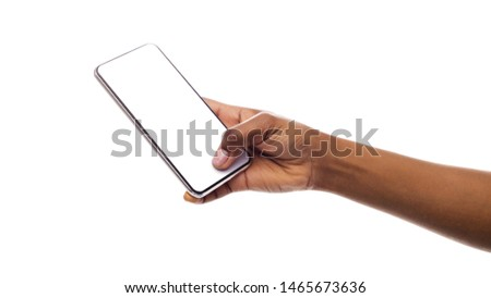 Afro woman's hand holding mobile phone with blank screen isolated on white. Panorama with empty space