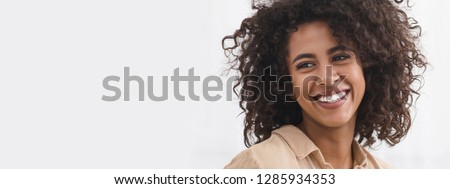 Afro woman smiling with white teeth, copy space