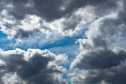 After a rain shower, the clouds finally break up to reveal a blue sky and sunshine once more.