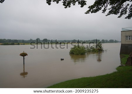 After a weekend of non-stop rainfall the water in the river Maas in Arcen the Netherlands has reached a level of almost 2 metres above normal (as of July 15,2021) Stockfoto ©