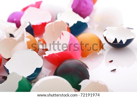after easter scenario, colorful eggshells on white...........