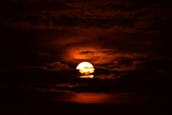 After eclipse, the red moon hides behind black clouds