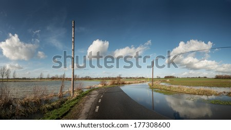 after much rain a road on boreham essex has become flooded