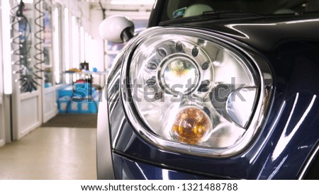After professional polishing, ceramics and car washes show headlights on new cars. Concept of: Auto Service, Different Colors, Car wash, Presentation, Glittering Headlights.  #1321488788
